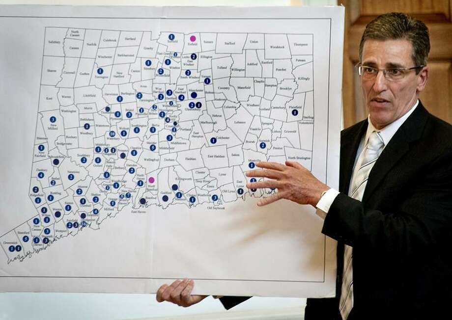 MI:LFORD-Milford Police Chief. Keith Mello, holds up a map of Connecticut dueing a public presentation on School Resource Officers.  The Circles indicate the number of Resource Officers in each city.  Milford has none.      Melanie Stengel/Register