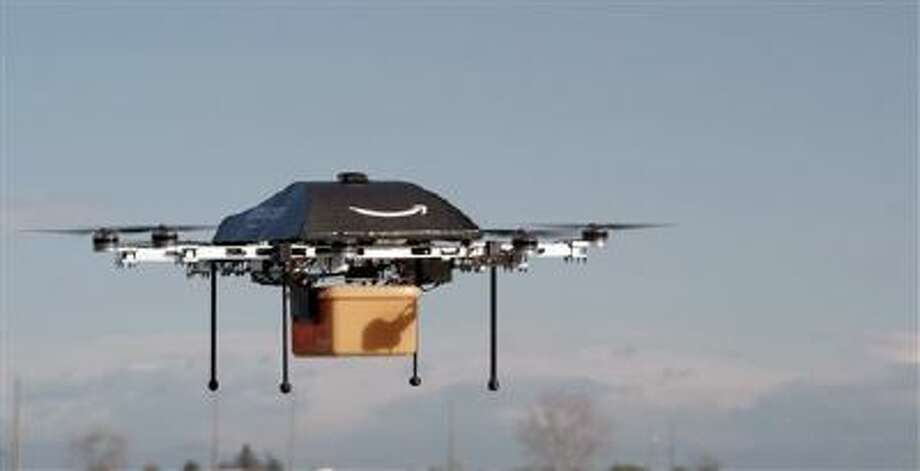 This undated image provided by Amazon.com shows the so-called Prime Air unmanned aircraft project that Amazon is developing. Amazon says it will take years to advance the technology and for the Federal Aviation Administration to create the necessary rules and regulations, but CEO Jeff Bezos said there's no reason drones can't help get goods to customers in 30 minutes or less. Photo: ASSOCIATED PRESS / AP2013