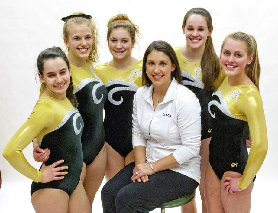 Members of the Hand gymnadtics team that made All Area and head coach Kelly Smith(center)                                          Melanie Stengel/Register