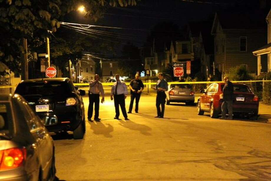 Investigators on the scene of the shooting in New Haven Thursday night. Rich Scinto/New Haven Register.