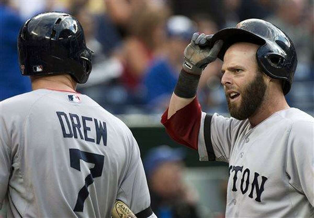 Boston Red Sox second baseman Dustin Pedroia, right, reacts to his teammate Stephen Drew after Pedroia was tagged out at home plate against the Toronto Blue Jays during the first inning of a baseball game in Toronto on Thursday, Aug. 15, 2013. (AP Photo/The Canadian Press, Nathan Denette)