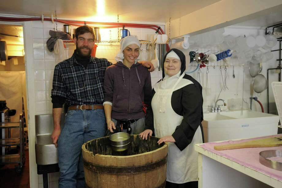 Sister Noella Marcellino, apprentice Stephanie Cassidy, and cheese maker Brother David Aeschliman.
