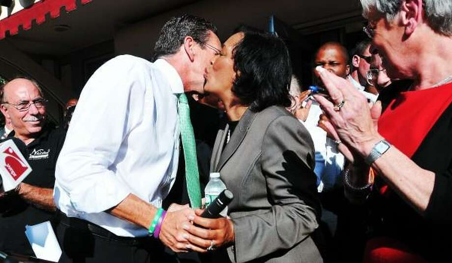"""Senator Toni Harp smooches with Governor Dannel P. Malloy after Malloy endorsed Harp's mayoral bid for New Haven. Governor Malloy, Lt. Governor Nancy Wyman and Senator Martin Looney endorsed Harp during a rally at Nica's Market in New Haven. Peter Casolino/New Haven Register <a href=""""mailto:pcasolino@newhavenregister.com"""">pcasolino@newhavenregister.com</a>"""