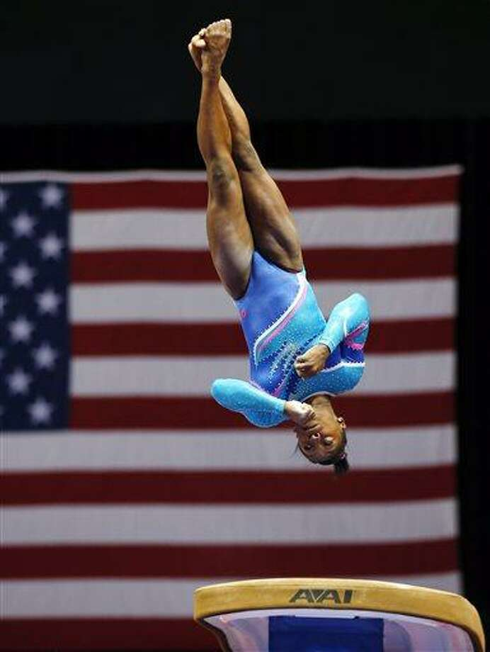 Simone Biles competes on the vault during the U.S. women's national gymnastics championships in Hartford, Conn. Thursday, Aug. 15, 2013. (AP Photo/Elise Amendola) Photo: AP / AP