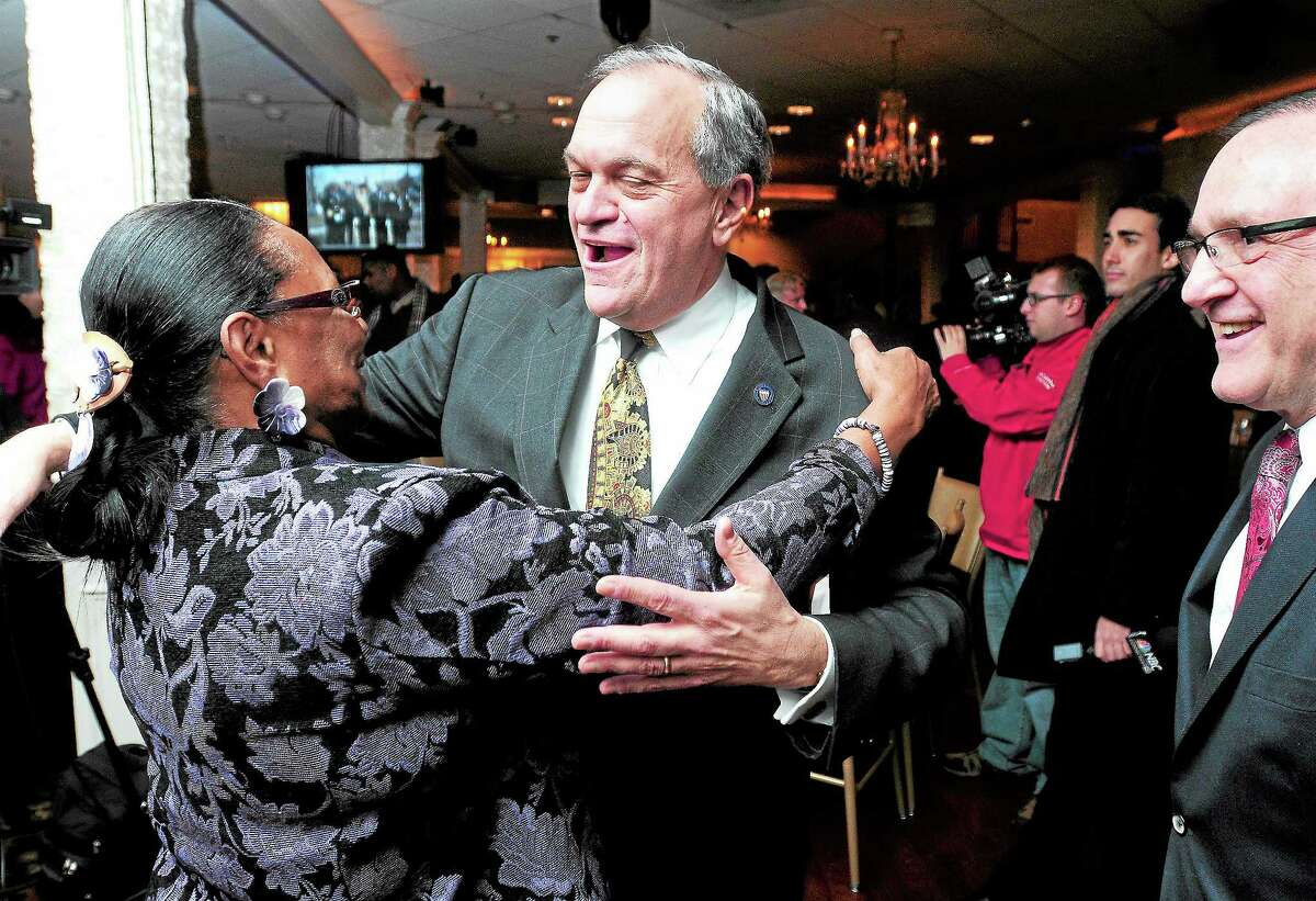 (Arnold Gold — New Haven Register) Jennifer Rawlings (left) embraces outgoing New Haven Mayor John DeStefano, Jr., at a celebration in DeStefano's honor at Anthony's Ocean View in New Haven on 11/20/2013.