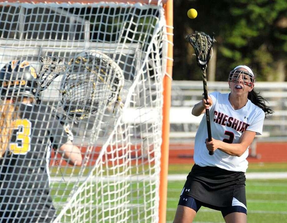 "Cheshire-- Cheshire's Kathleen Kalbian blasts a first half goal past Hand goalie Lindsay Wargo. Photo-Peter Casolino/Register <a href=""mailto:pcasolino@newhavenregister.com"">pcasolino@newhavenregister.com</a>"