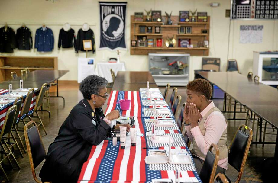 David Goldman — The Associated Press file photo   U.S Air Force Staff Sgt. Bri Smith, 31, right, of Atlanta, samples a facial moisturizer product while talking with Mary Kay consultant Asenath Holmes Pitner, left, during a job fair for veterans at the VFW Post 2681, in Marietta, Ga. Photo: AP / AP