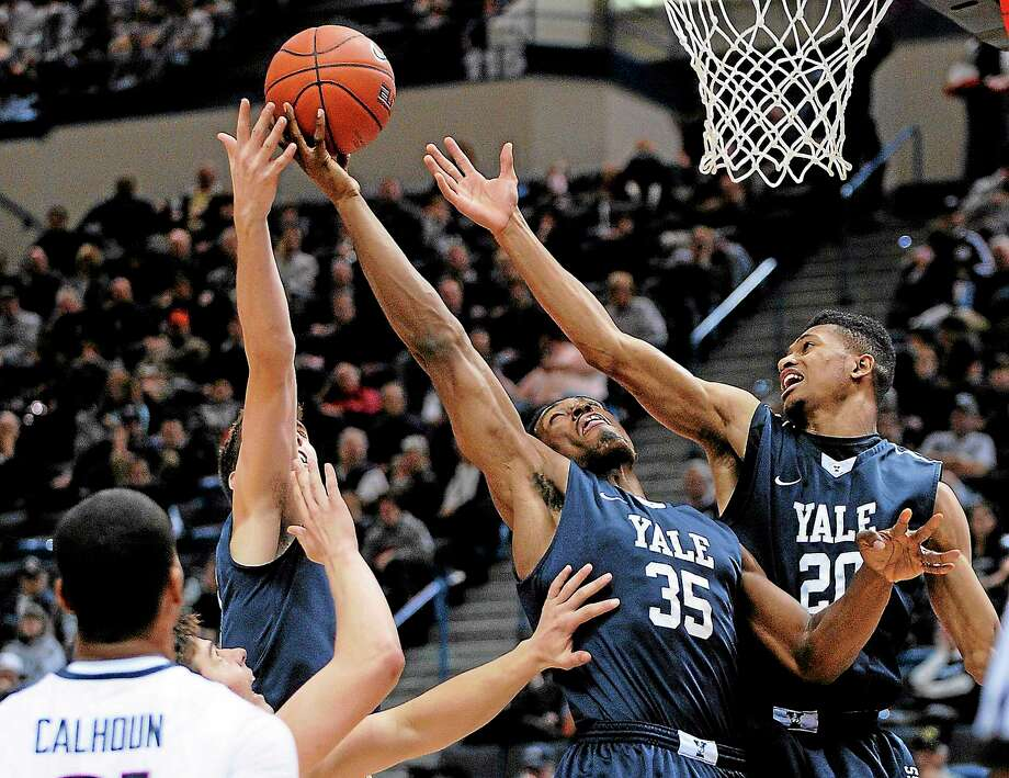 From left, Nick Victor, Brandon Sherrod, Javier Duren and Yale will battle Bryant Wednesday night at 7:30 p.m. in New Haven. Photo: Fred Beckham — The Associated Press   / FR153656 AP
