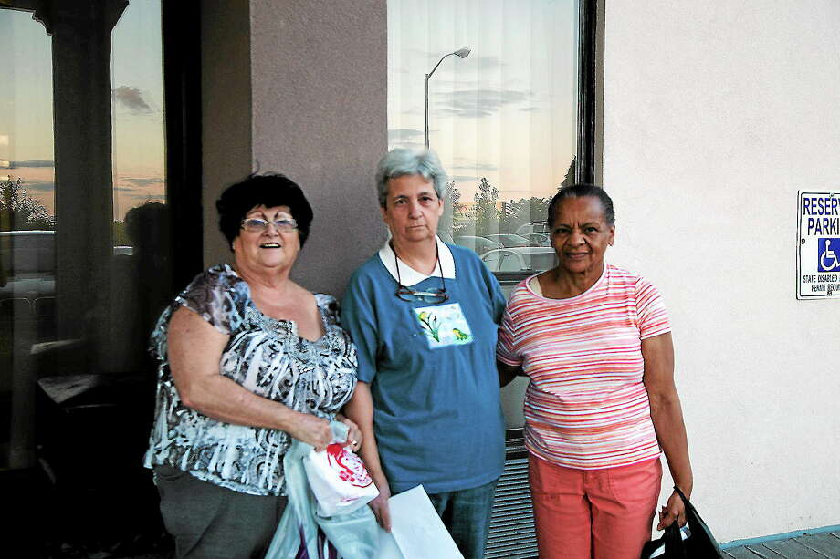 Left to right: Displaced Bella Vista Apartment residents Diance Church, Elizabeth Savo and Dottice Barnes stand outside the Best Western in West Haven. The hotel will likely be their temporary home in the days and weeks to come. Photo by Rich Scinto/ New Haven Register. Photo: Journal Register Co.