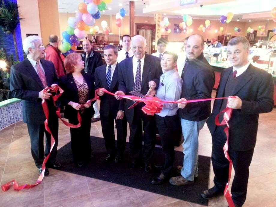 From left: Paul Mayer, BIC USA; Robin Wilson, president of North Haven Chamber of Commerce; First Selectman Michael J. Freda; Frank Bowser, of PPG Properties and Holdings; Jason Wang, manager of Hibachi Grill & Supreme Buffet; Bryan Bowser, of PPG Properties and Holdings; and Drew Huggins, of Hibachi Grill.