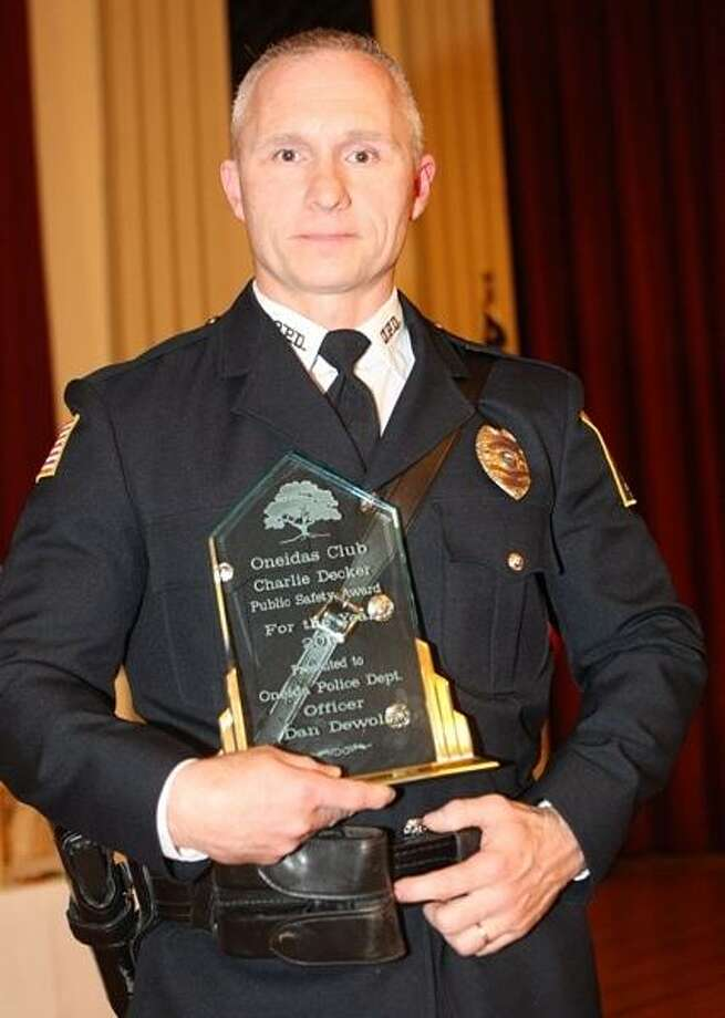 PHOTO BY JOHN HAEGER @ ONEIDAPHOTO ON TWITTER/ONEIDA DAILY DISPATCH Oneida City Policer Officer Daniel DeWolf named Police Officer of the Year  during the annual Oneidas Club Charlie Decker Public Safety Dinner on Friday, May 3, 2013 in Oneida.