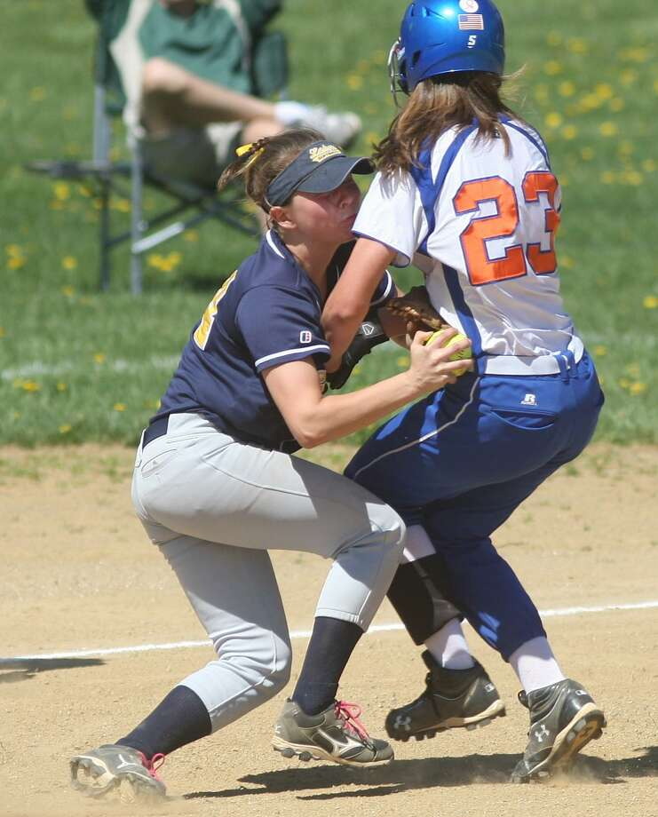 PHOTO BY JOHN HAEGER @ONEIDAPHOTO ON TWITTER/ONEIDA DAILY DISPATCH Cazenovia's Rachel McLaughlin (24) holds onto the ball to tag Oneida's Samantha Lusher (23) out as they collide in the bottom of the second inning of their on Saturday, May 4, 2013 in Oneida.