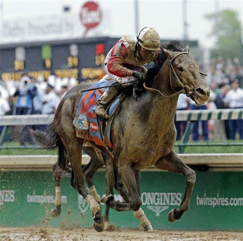 Joel Rosario rides Orb during the 139th Kentucky Derby at Churchill Downs Saturday, May 4, 2013, in Louisville, Ky. (AP Photo/J. David Ake) Photo: AP / AP
