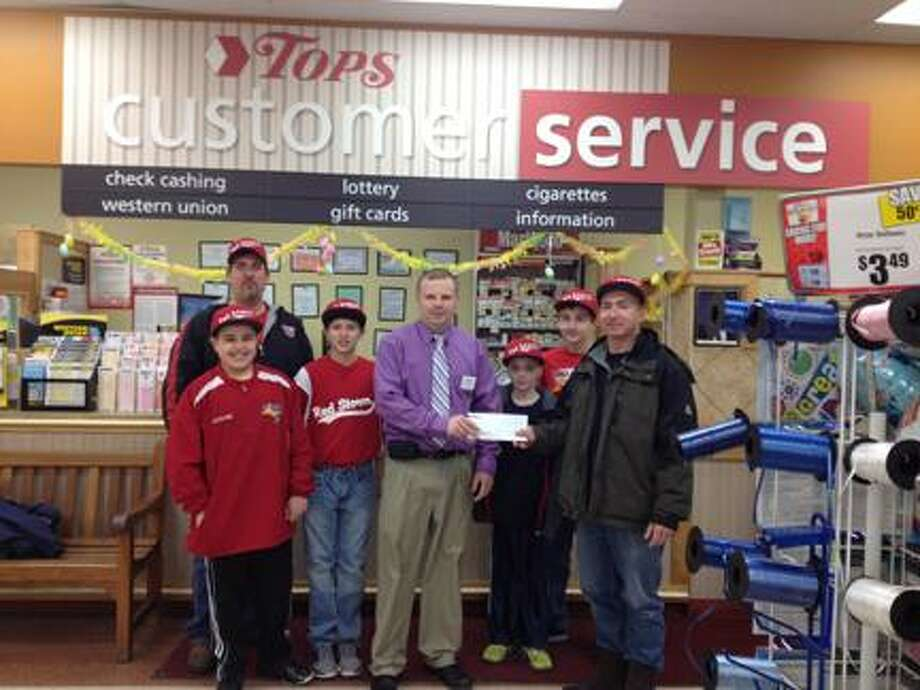Photo Courtesy Tops Markets Tops Markets in Sherrill recently made a donation to the Red Storm 12U travel baseball team for uniforms.