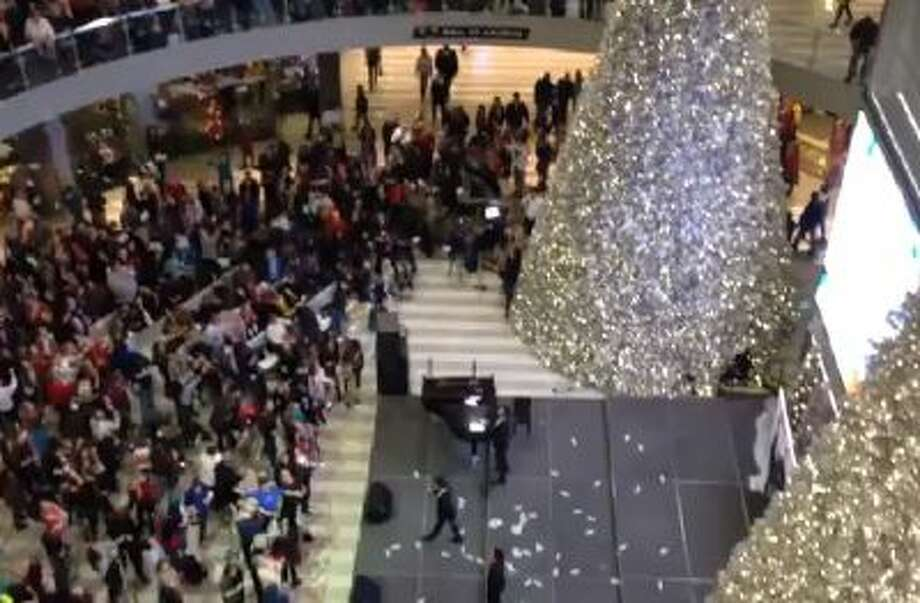 A man dropped $1,000 in $1 bills on a crowd at the Mall of America in Minnesota on Black Friday.