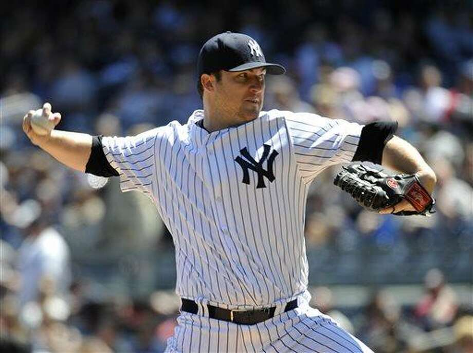 New York Yankees starting pitcher Phil Hughes throws against the Oakland Athletics in the first inning of a baseball game at Yankee Stadium on Saturday, May 4, 2013 in New York. (AP Photo/Kathy Kmonicek) Photo: AP / FR170189 AP