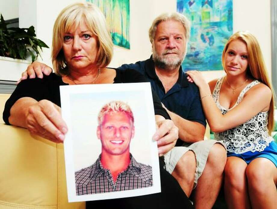 Claudia Wolf Vece holds a photograph of her son Ronald Vece, Jr. of Bethany, 24, killed in a motorcycle crash in West Haven last month. . With Wolf Vece is her husband Ron Vece and her daughter Coco Vece, 17, in their Bethany, Conn. home Thursday August 7, 2013. Peter Hvizdak/New Haven Register Photo: New Haven Register / ©Peter Hvizdak /  New Haven Register