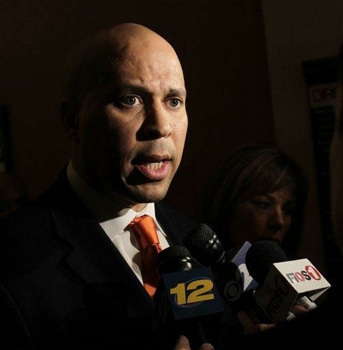 """Candidate: Cory Booker Policy pledge: Executive action for nonviolent drug offenders In June, the Democratic U.S. Senator from New Jersey proposed executive action that would """"offer clemency to thousands of nonviolent drug offenders on his first day in office."""" Back in March, Booker proposed a new bill on social media that would """"cut mandatory minimums for nonviolent drug offenses,"""" and """"ban racial and religious profiling."""" In 2018, as part of a recently enacted bill, Booker wanted to forbid solitary confinement for juveniles in federal prisons. (Photo Credit: The Associated Press)"""