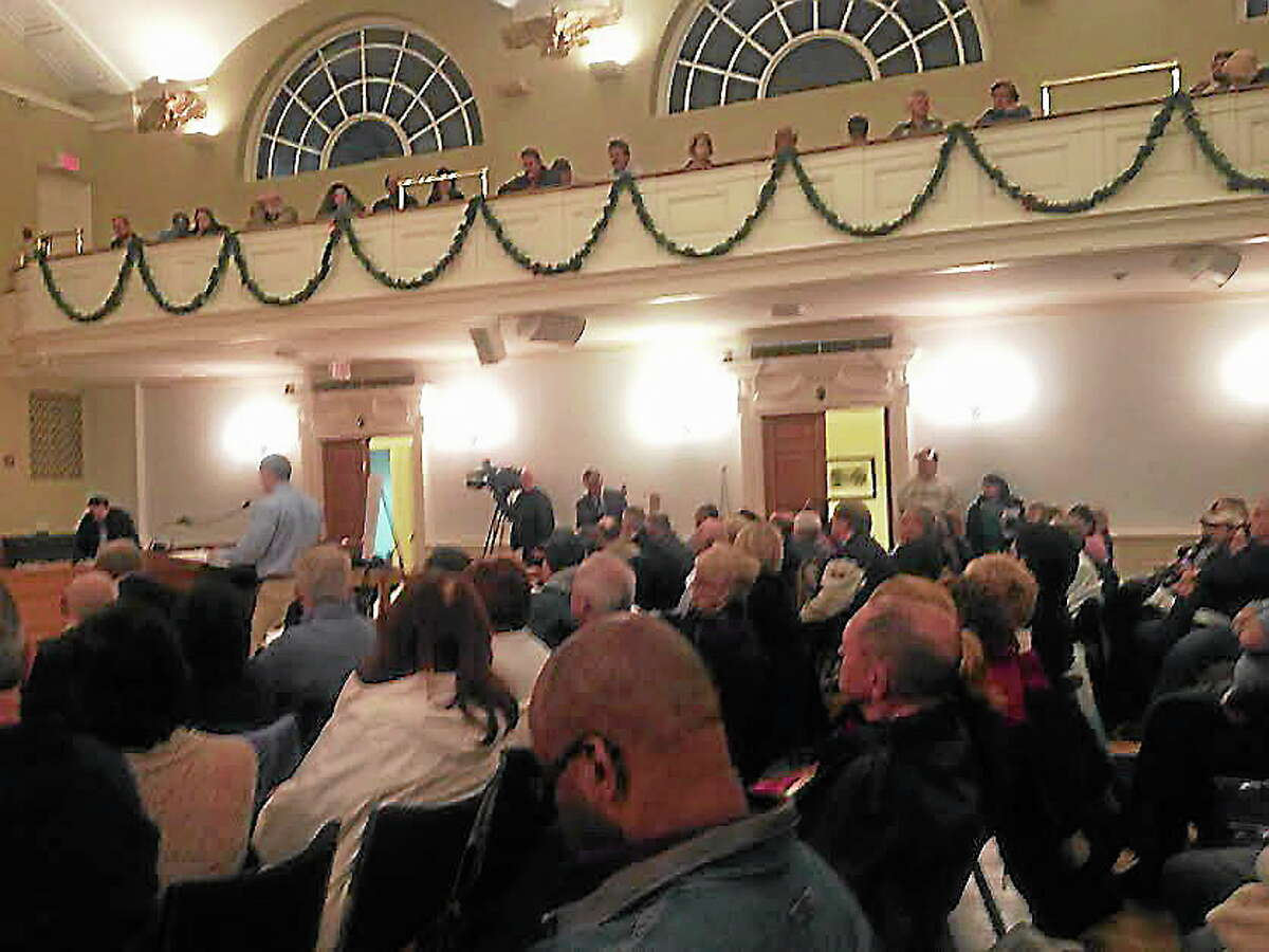 About 200 residents showed up for the second part of a Planning and Zoning board hearing on two proposed multi-unit housing developments in Milford. Rachel Chinapen/New Haven Register.