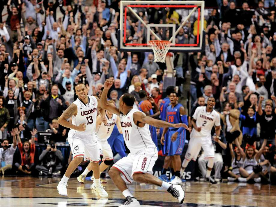 Connecticut's Shabazz Napier, left, and Ryan Boatright, right, react after Napier hits the game-winning basket at the end an NCAA college basketball game against Florida, Monday, Dec. 2, 2013, in Storrs, Conn. Connecticut won 65-64. (AP Photo/Jessica Hill) Photo: AP / FR125654 AP