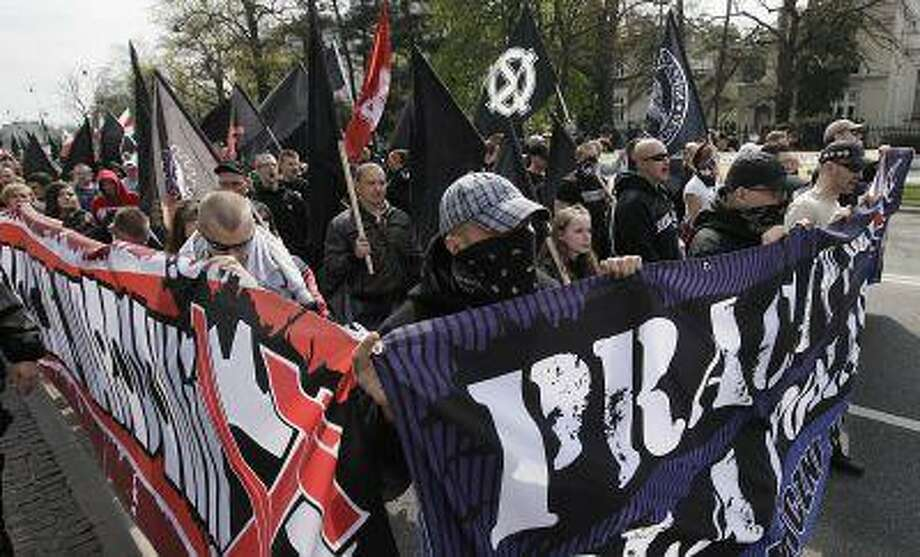 Protestors gesture and shout slogans during a May Day demonstration organized by far-right organizations in Warsaw, Poland, Wednesday, May 1, 2013. (AP Photo/Czarek Sokolowski) Photo: AP / AP