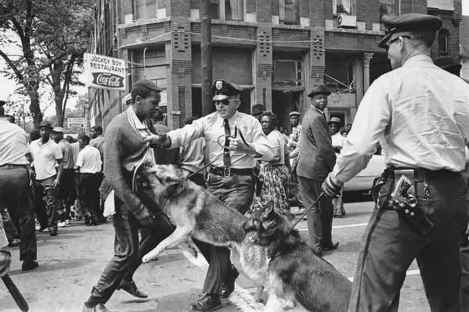A 17-year-old civil rights demonstrator, defying an anti-parade ordinance of Birmingham, Ala., is attacked by a police dog on May 3, 1963.  On the afternoon of May 4, 1963, during a meeting at the White House with members of a political group, President Kennedy discussed this photo, which had appeared on the front page of that day's New York Times.   (AP Photo/Bill Hudson) Photo: AP / 1963 AP