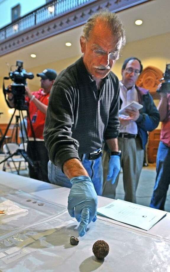 "New Haven--State Archeologist Nick Bellantoni explains items inside the time capsule found on the New Haven Green. Including ""grape shot,"" right, and a bullet, both labeled from Gettysburg. Photo-Peter Casolino/Register <a href=""mailto:pcasolino@newhavenregister.com"">pcasolino@newhavenregister.com</a>"