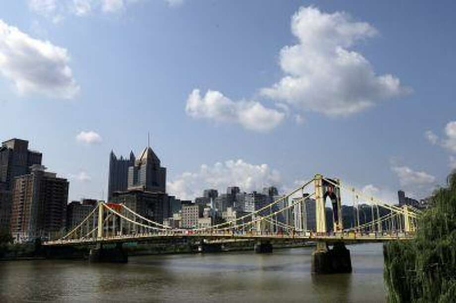 This is the Andy Warhol bridge on Monday, Aug. 12, 2013, in downtown Pittsburgh after more than 1,800 knitters covered the bridge in 3,000 feet of colorful yarn. Photo: ASSOCIATED PRESS / AP2013