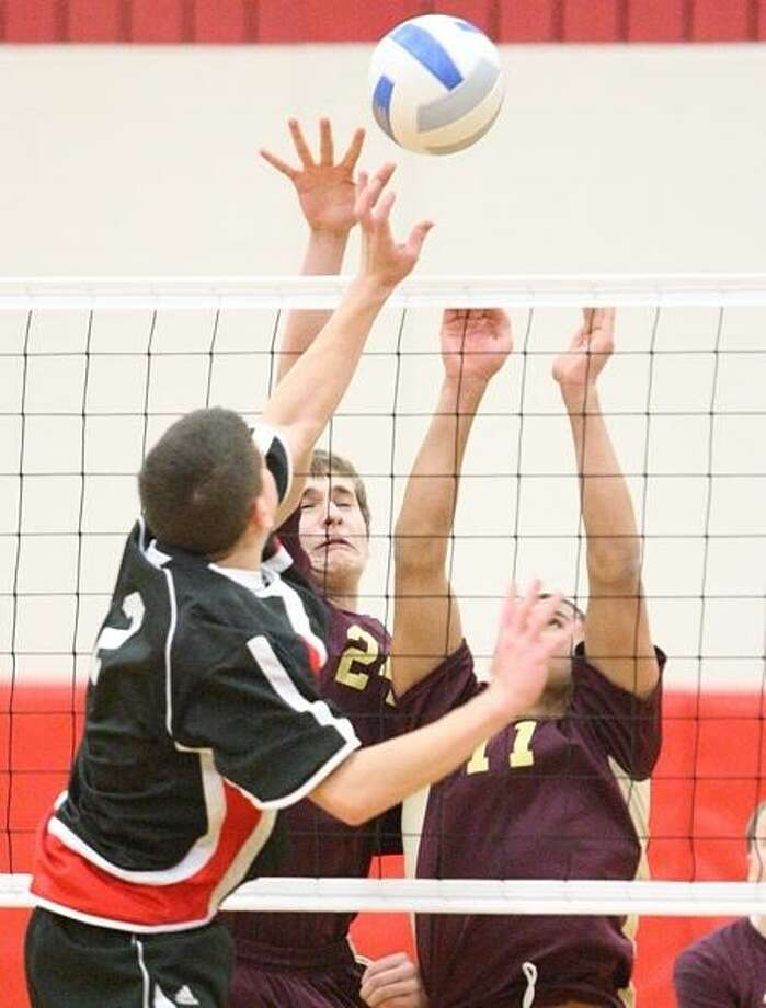 Dispatch Staff Photo by JOHN HAEGER  @OneidaPhoto on Twitter Chittenango's Zach McCarthy (2) has his shot blocked by Canastota's Michael McDermott (24) and Avery Brennen (11) during the first game of their match in Chittenango on Wednesday, Feb. 27, 2013.