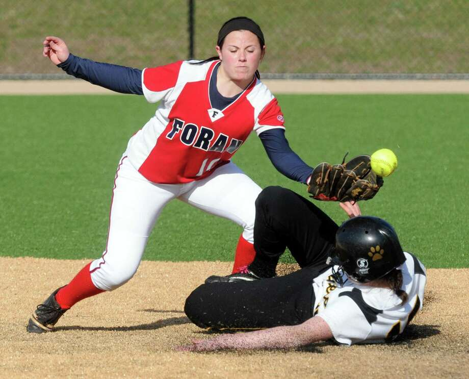 """Foran's Marissa Bruno not making the putout as Hand's Kate Boudreau slides safely into second from a game earlier this month. Foran fell to Sacred Heart Academy on Monday. Mara Lavitt/New Haven Register <a href=""""mailto:mlavitt@newhavenregister.com"""">mlavitt@newhavenregister.com</a>"""