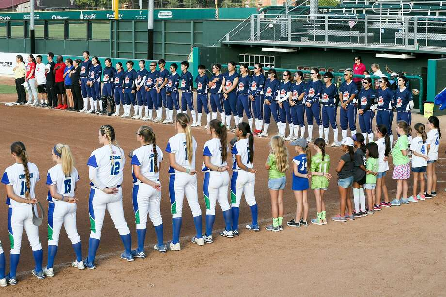The Beijing Shougang Eagles (top) and the Texas Chargers stand at attention as the Chinese National Antham in sung prior to their National Pro Fastpitch league game at Bobcat Softball Stadium in San Marcos on Tuesday, July, 25, 2017.  MARVIN PFEIFFER/ mpfeiffer@express-news.net Photo: Marvin Pfeiffer, Staff / San Antonio Express-News / Express-News 2017