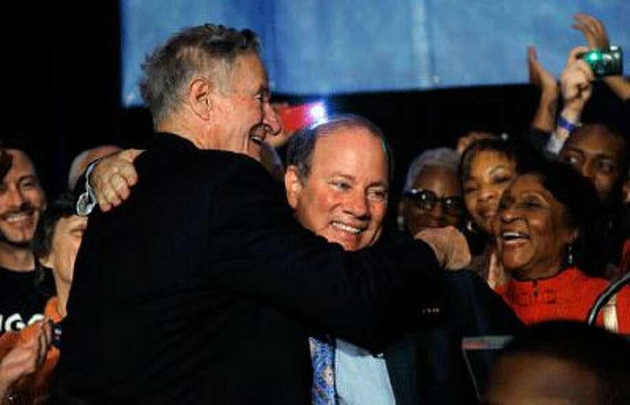 Detroit voters elected Mike Duggan, right, as mayor Nov. 5.