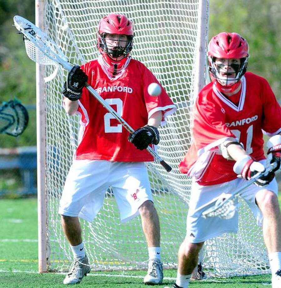 Goalie Hunter Duval (left) and Connor Bradshaw (right) of Branford defend against Notre Dame-West Haven on 4/30/2013.Photo by Arnold Gold/New Haven Register