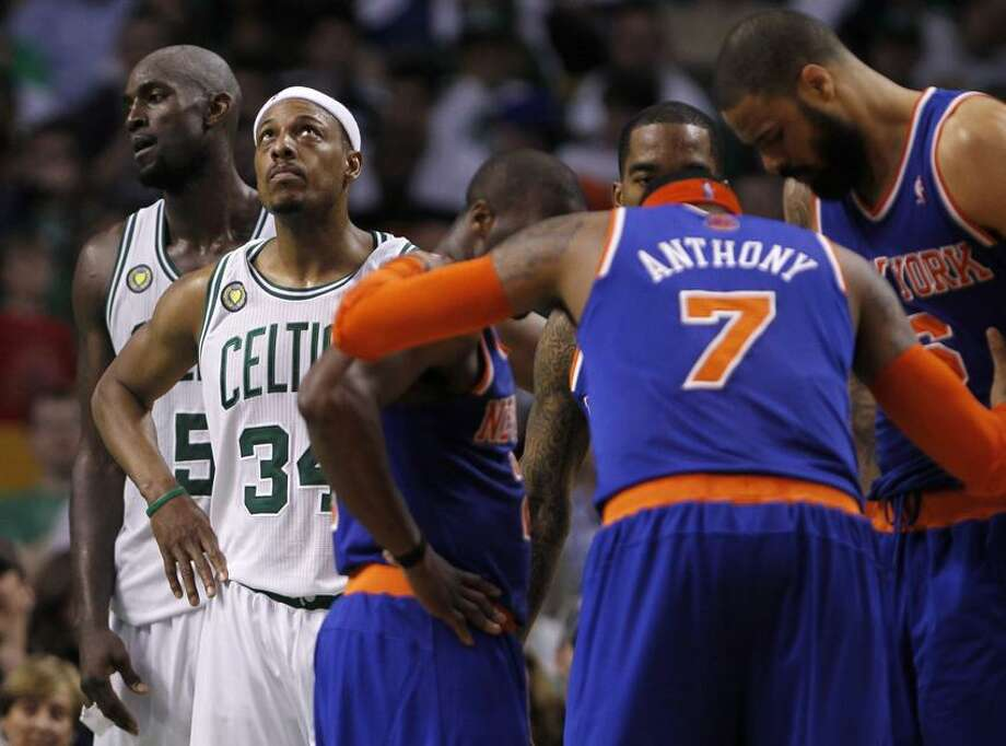 (L-R) Boston Celtics' Kevin Garnett and Paul Pierce react as New York Knicks' Raymond Felton, J.R. Smith, Carmelo Anthony and Tyson Chandler huddle during the fourth quarter of Game 6 of their NBA Eastern Conference semifinal playoff basketball series in Boston, Massachusetts May 3, 2013. REUTERS/Jessica Rinaldi (UNITED STATES - Tags: SPORT BASKETBALL) Photo: Reuters / X01704