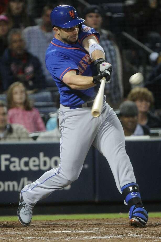 New York Mets' David Wright (5) hits a home run against the Atlanta Braves during the ninth inning of a baseball game, Friday, May 3, 2013, in Atlanta. (AP Photo/John Amis) Photo: ASSOCIATED PRESS / AP2013
