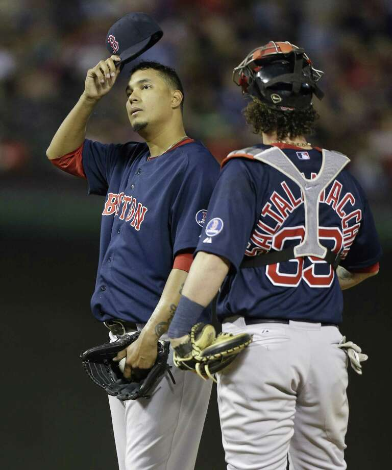 Boston Red Sox starting pitcher Felix Doubront, left, takes off his cap and looks up next to catcher Jarrod Saltalamacchia after giving up five runs to the Texas Rangers during the fourth inning of a baseball game Friday, May 3, 2013, in Arlington, Texas. (AP Photo/LM Otero) Photo: ASSOCIATED PRESS / AP2013