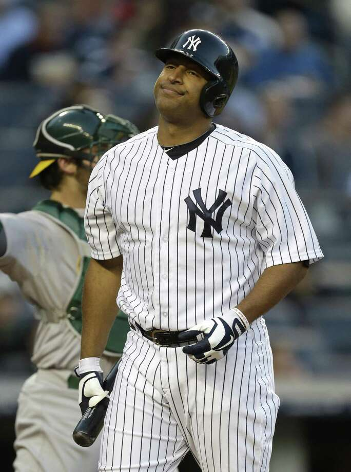 New York Yankees' Vernon Wells reacts after striking out on a throw from Oakland Athletics starting pitcher A.J. Griffin during the first inning of a baseball game at Yankee Stadium in New York, Friday, May 3, 2013. (AP Photo/Julio Cortez) Photo: AP / AP