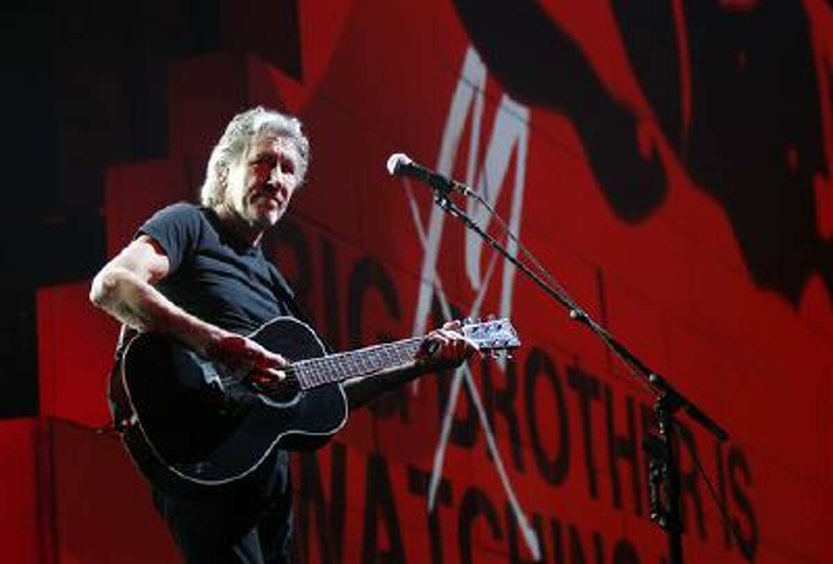 """In this April 1, 2011 file photo, Roger Waters performs during his """"The Wall Tour 2010/2011"""" in Milan, Italy. Now that his three-year world tour for ?The Wall? has finally come to an end, Waters wants to set the record straight over criticism he?s received from Jewish groups regarding his use of the Star of David symbol in the show and his support for a cultural boycott of Israel."""