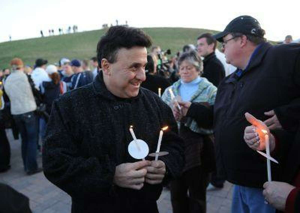 Columbine High School Principal Frank DeAngelis attends a candlelight vigil at the Columbine Memorial at Clement Park near Littleton, Colo., on Sunday, April 19, 2009. DeAngelis was the principal at the time of the attack.