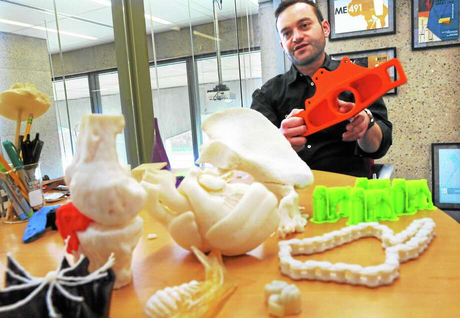 (Mara Lavitt — New Haven Register) November 19, 2013 New HavenYale's Center for Engineering Innovation and Design where members of the Yale community can realize their ideas using 3D printers. CEID assistant director Joseph Zinter with just some of the items made at the Center. Photo: Journal Register Co. / Mara Lavitt