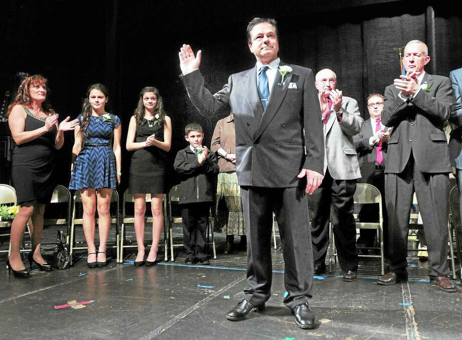 (Arnold Gold — New Haven Register)  Ansonia Mayor David Cassetti waves to a packed house in the auditorium of Ansonia High School after being sworn into office on 12/2/2013. Photo: Journal Register Co.