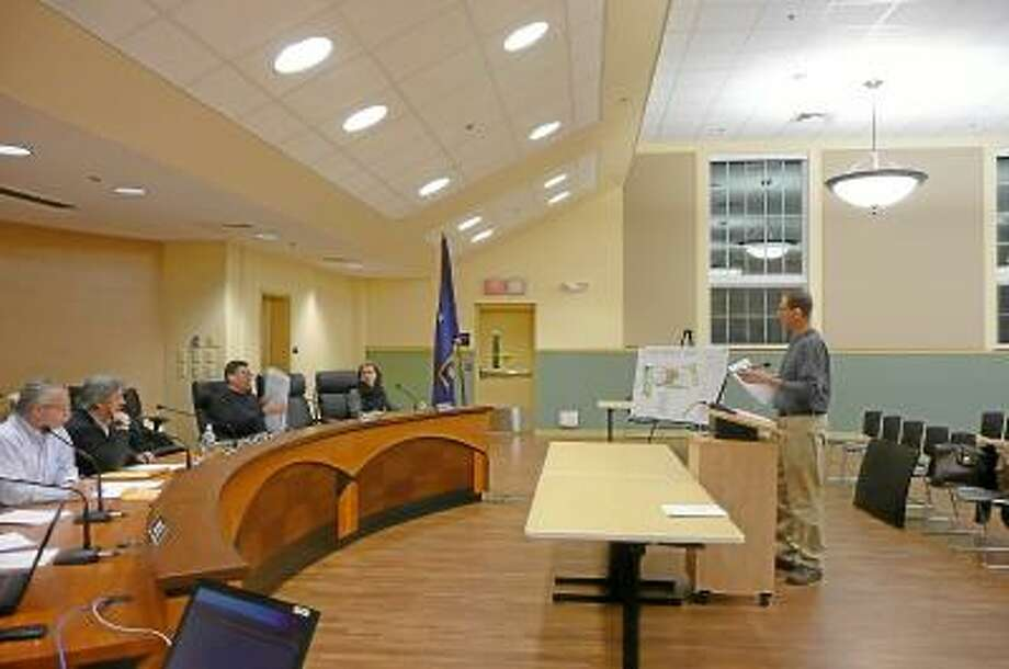 Ken Hrica, engineer, presented plans for an addition to the Community Health & Wellness Center and the Planning and Zoning meeting. Kate Hartman/Register Citizen.