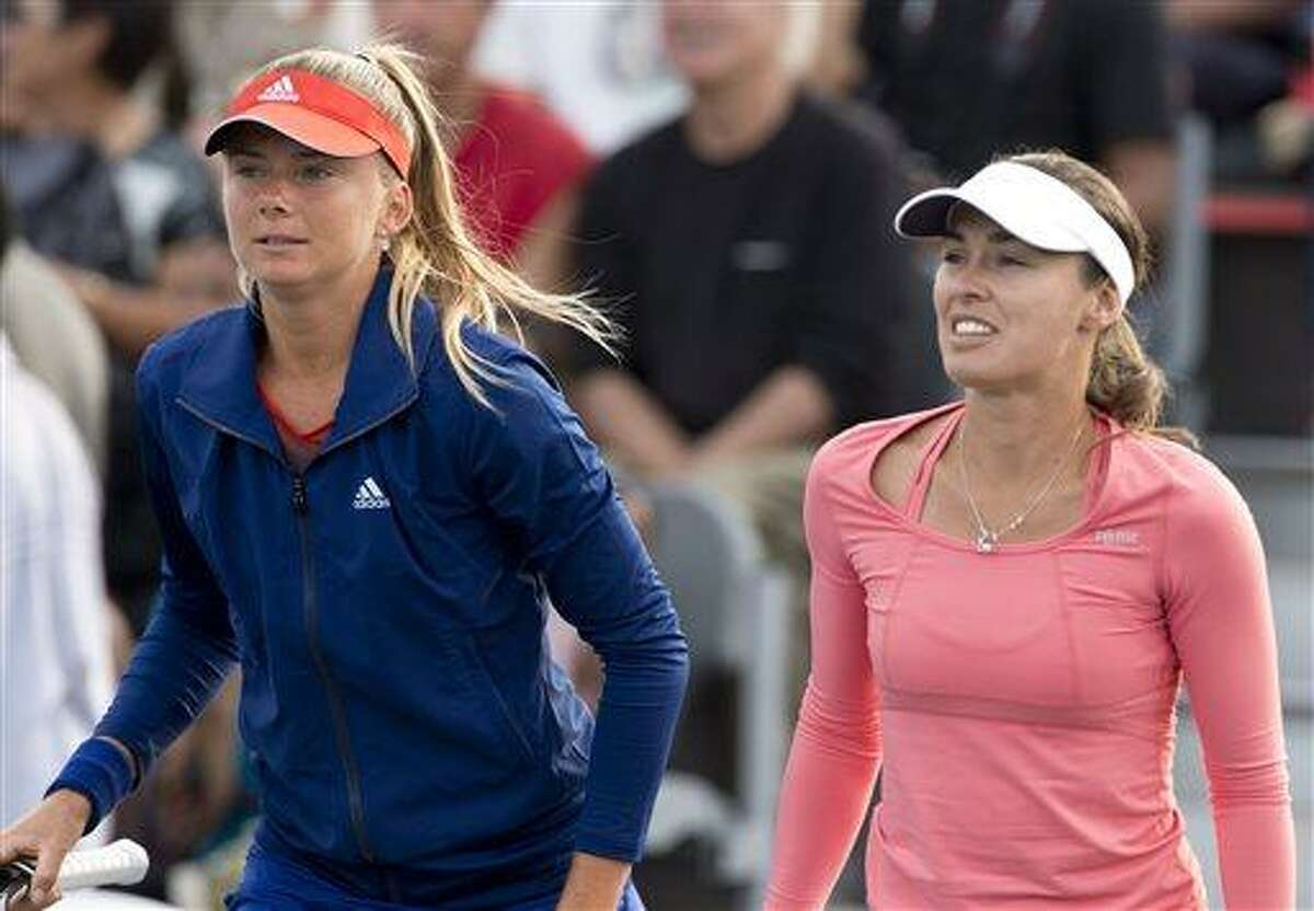 Daniela Hantuchova of Russia, left, and doubles partner Martina Hingis of Switzerland pause during their Rogers Cup women's doubles match earlier this month. Hantuchova will play singles and doubles at the New Haven Open next week. (AP Photo/The Canadian Press, Frank Gunn)
