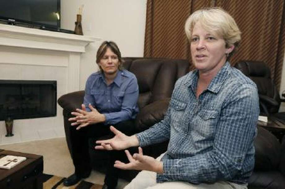 In this Nov. 5, 2013 photo, Dawn Jefferies, right, speaks in Hernando, Miss., about the efforts Lauren Beth Czekala-Chatham, left, has taken to get the state to recognize a same-sex marriage performed in California, so Czekala-Chatham can now divorce that partner she lived with as a couple in DeSoto County, until they separated in 2010.