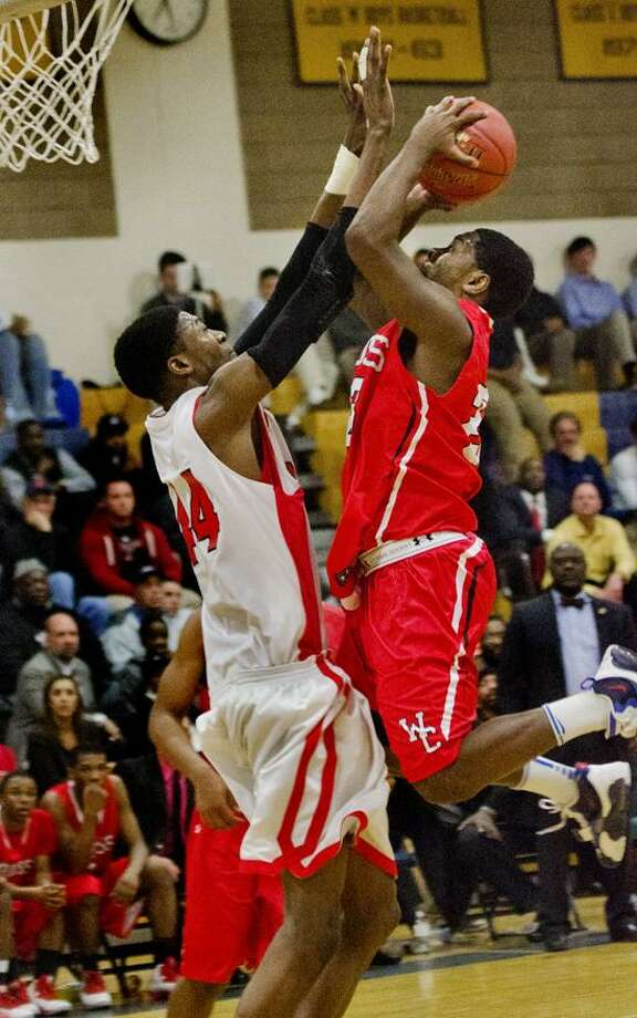 "Sports --Wilbur Cross vs. Farifield Press boys basketball SCC semifinal.  Jaylin Fuller, of Wilbur Cross hit a wall in the form of  Fairfield Prep's  Paschal Chukwu in 2nd half action.     Photos by Melanie  Stengel   <a href=""mailto:mstengel@nhregister.com"">mstengel@nhregister.com</a>"