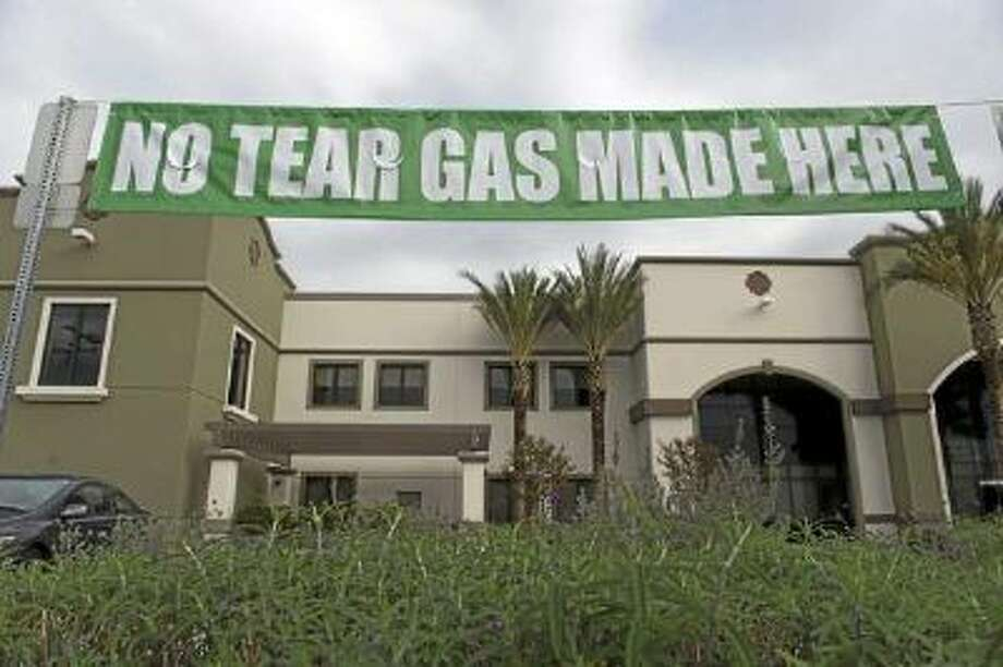 uy Fong Foods posted banners defending its manufacturing process for their famous Sriracha chili sauce at the Irwindale facility on Friday, Dec. 29, 2013.