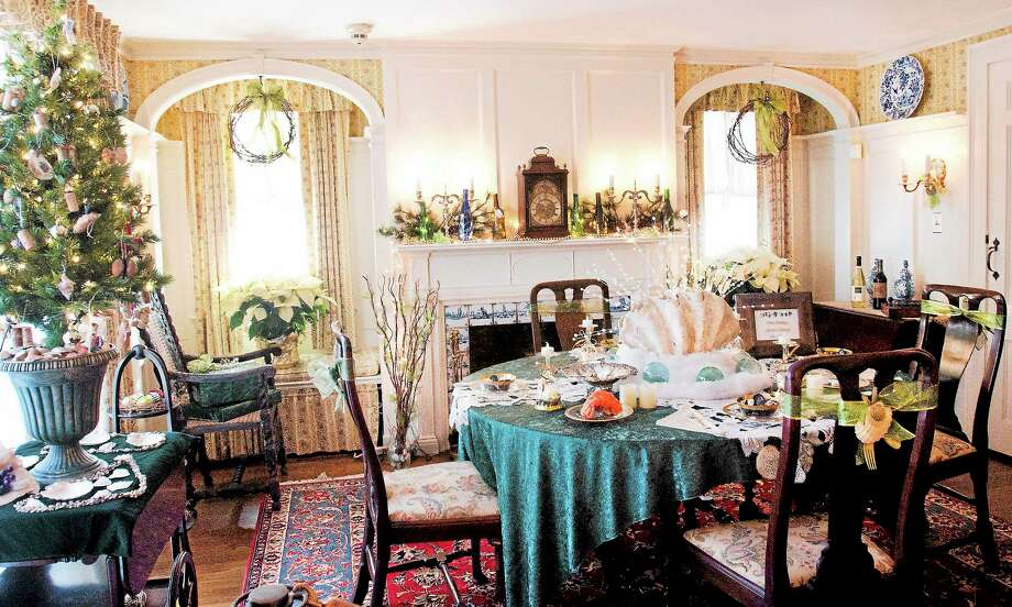(Melanie Stengel — New Haven Register)  The table is set for an elegant seafood dinner at the Frances Osbourne Kellog Homestead Museum. Holiday tours began 11/29/. Photo: Journal Register Co.