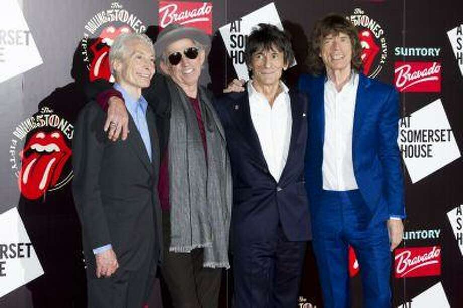 From left, Charlie Watts, Keith Richards, Ronnie Wood and Mick Jagger, from the British Rock band, The Rolling Stones, as they arrive at a central London venue, to mark the 50th anniversary of the Rolling Stones first performance. The Rolling Stones will be taking the stage again this summer at one of Britain's leading music festivals. Photo: ASSOCIATED PRESS / A2012
