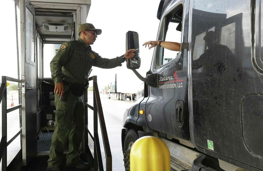 A Border Patrol agent at the inspection checkpoint 27 miles north of Laredo on Interstate 35 last year.  Agents followed an ambulance carrying an undocumented mother and her 4-year-old son to University Hospital in San Antonio after it cleared the checkpoint, then detained the woman at the hospital for several hours. (Kin Man Hui/San Antonio Express-News) Photo: Kin Man Hui /San Antonio Express-News / ©2017 San Antonio Express-News
