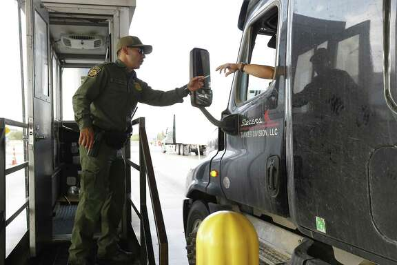 A Border Patrol agent at the inspection checkpoint 27 miles north of Laredo on Interstate 35 last year.  Agents followed an ambulance carrying an undocumented mother and her 4-year-old son to University Hospital in San Antonio after it cleared the checkpoint, then detained the woman at the hospital for several hours. (Kin Man Hui/San Antonio Express-News)